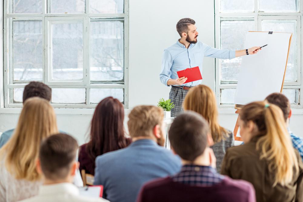 man teaching english